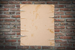 Old paper on brick wall, clipping path. Royalty Free Stock Photo