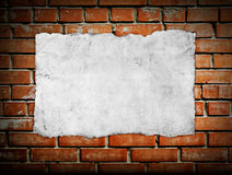 Old paper on brickwall Stock Photography