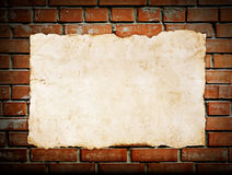 Old paper on brickwall Royalty Free Stock Photos