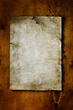 Old paper on brown wood Royalty Free Stock Photography