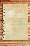 Old paper and brown wood texture. Old paper on brown wood texture with natural patterns stock photo