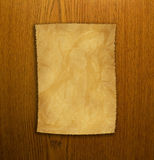 Old paper and brown wood texture. Old paper on brown wood texture Royalty Free Stock Images