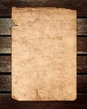 Old Paper on Brown Wood Texture Royalty Free Stock Photography