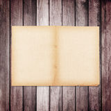 old paper on brown wood texture with natural linen texture Royalty Free Stock Image