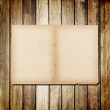 Old paper on brown wood texture with natural linen texture Stock Images