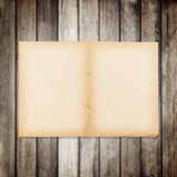 Old paper on brown wood texture with natural linen texture Royalty Free Stock Photos