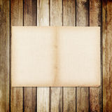 old paper on brown wood texture with natural linen texture. Royalty Free Stock Photography