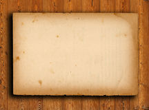 old paper on brown wood texture Stock Image