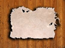 Old paper on brown wood texture with natural patte Stock Images