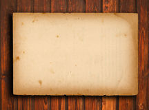 Old paper on brown wood texture with natural patte Royalty Free Stock Images