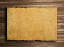 Old paper on brown wood texture with natural patte Royalty Free Stock Image