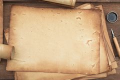 Old paper on brown wood texture with pen and ink. For background stock photography