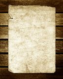 Old Paper on Brown Wood Texture Sepia. Sepia old paper on brown wood texture, horizontal slats from a weathered bench Royalty Free Stock Image