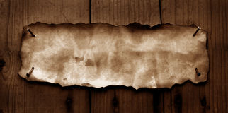 Old paper with burned edges. For background stock photo