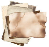 Old paper with burned edges on bunch of vintage photos Royalty Free Stock Images