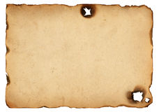 Old paper with burnt edges. Isolated on white background royalty free stock photo
