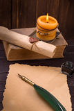 Old paper candle and quill pen Stock Photo