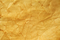 Old paper. Closeup of a yellowish and crumpled blank old paper stock images