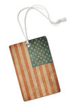 Old paper cloth tag with USA flag isolated Royalty Free Stock Image