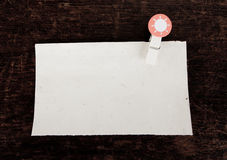 Old paper and clothes peg Royalty Free Stock Photo