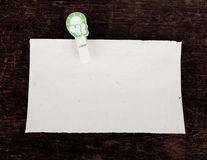 Old paper and clothes peg Royalty Free Stock Image