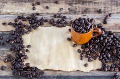 Old paper and coffee beans on wooden Royalty Free Stock Photos