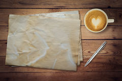 Old paper and coffee on wood table texture Stock Images