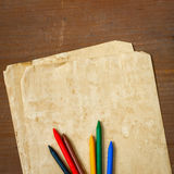 Old paper and colored pencils Stock Images
