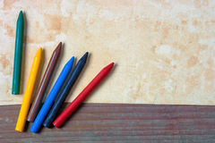 Old paper and colored pencils Royalty Free Stock Images