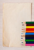 Old paper and colored pencils Royalty Free Stock Photo