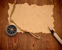 Old paper, compass, pen and rope Royalty Free Stock Images