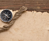 Old paper, compass and rope Royalty Free Stock Photos