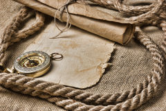 Old paper with compass and rope. On canvas Royalty Free Stock Images