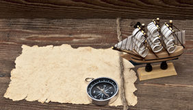 Old paper, compass, rope and model classic boat Royalty Free Stock Image