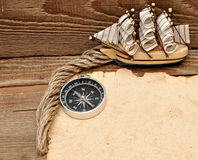 Old paper, compass, rope and model classic boat Stock Photos