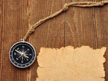 Old paper, compass and rope on wood background Stock Images