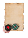 Old paper, compass and shells isolated on white background Stock Photos