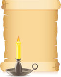Old paper and conflagrant candle in a candlestick Stock Photo