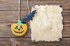 Old paper for congratulations with Halloween and homemade cookie Stock Images