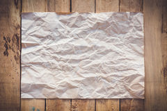 Old paper crumpled on wood background Royalty Free Stock Photography