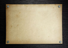 Old paper on the dark wood Royalty Free Stock Image