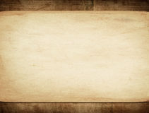 Old paper on dark wooden wall Stock Photo