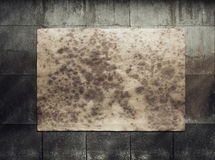 Paper on tile wall Royalty Free Stock Photo