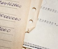 Old paper documents. Bookkeeping accountancy. Calculations. Hand-written and printed on the typewriter stock photo