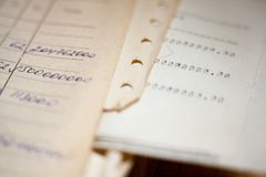 Old paper documents. Bookkeeping accountancy. Calculations. Hand-written and printed on the typewriter royalty free stock image