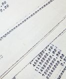 Old paper documents. Bookkeeping accountancy. Calculations. Printed on the typewriter stock image