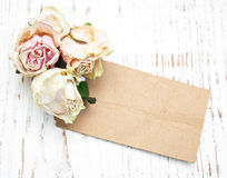 Old paper with dried roses Stock Photos
