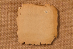 Old paper, empty yellow page on hessian canvas fabric royalty free stock photography