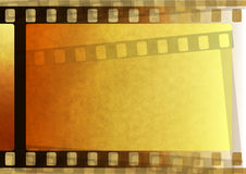 Old paper with film. Old brown paper with fragmentary filmstrip. Background Royalty Free Stock Photos