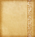 Old paper with floral ornament. Old worn paper with floral ornament royalty free stock photos